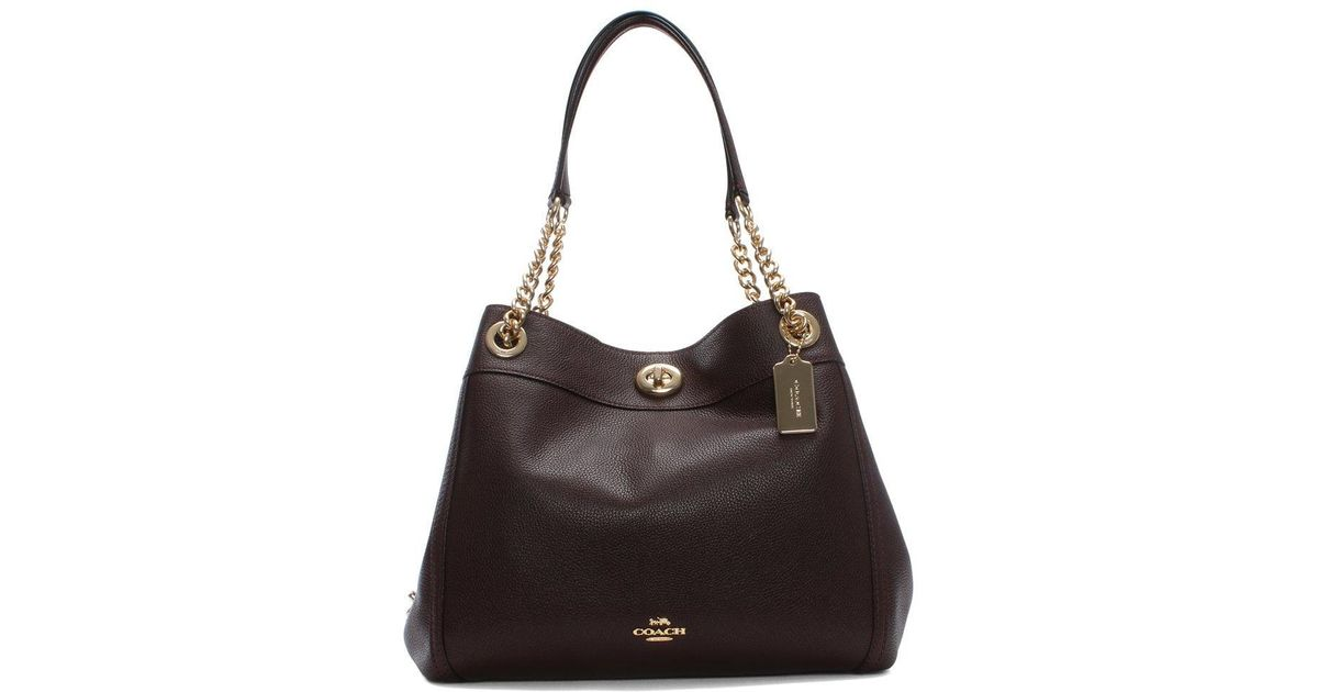 Lyst - Coach Turnlock Edie Oxblood Polished Pebbled Leather Shoulder Bag in  Black 9aef770376032