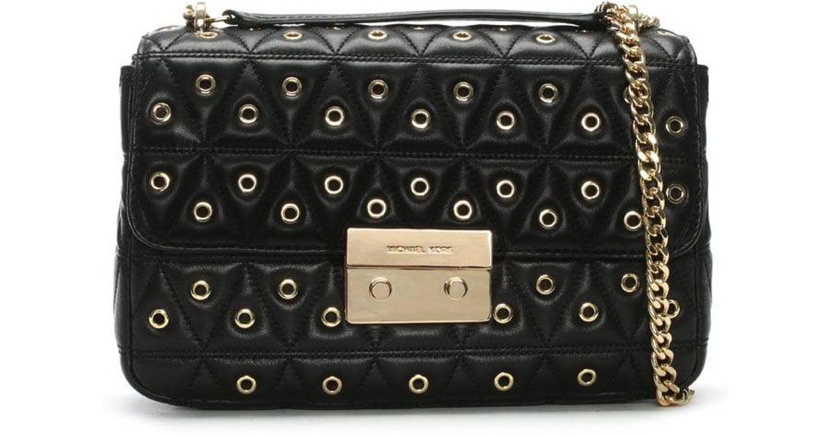 1e1c11ac9e13 Michael Kors Sloan Quilted Black Leather Grommet Shoulder Bag in Black -  Lyst