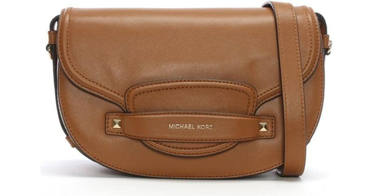 a45f5ba66a930b Michael Kors Medium Cary Acorn Leather Saddle Bag in Brown - Lyst