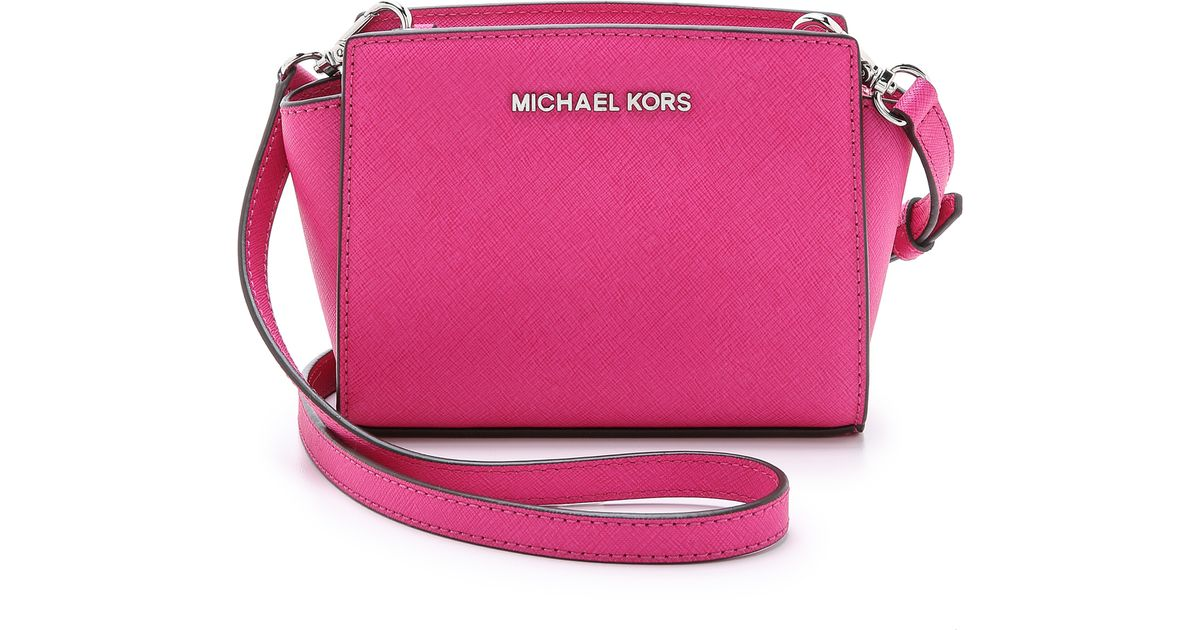 5657f22392fc ... promo code for michael michael kors selma mini messenger bag blossom in  pink lyst a9887 adec5
