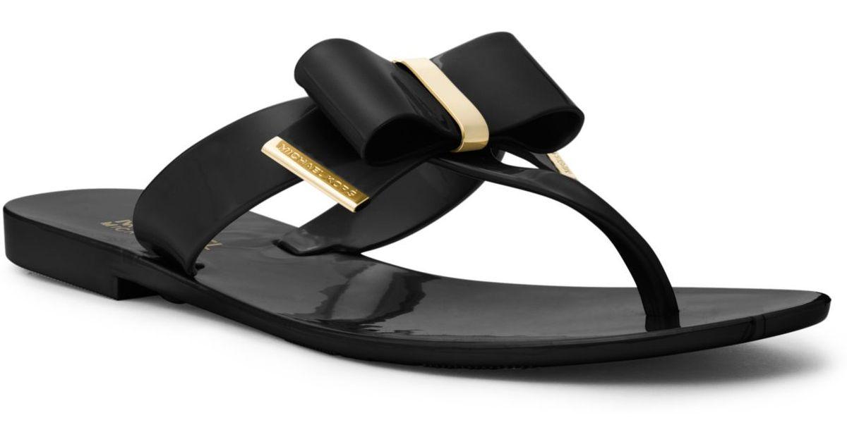 af3f34be417 Michael Kors Kayden Bow Sandal in Black - Lyst