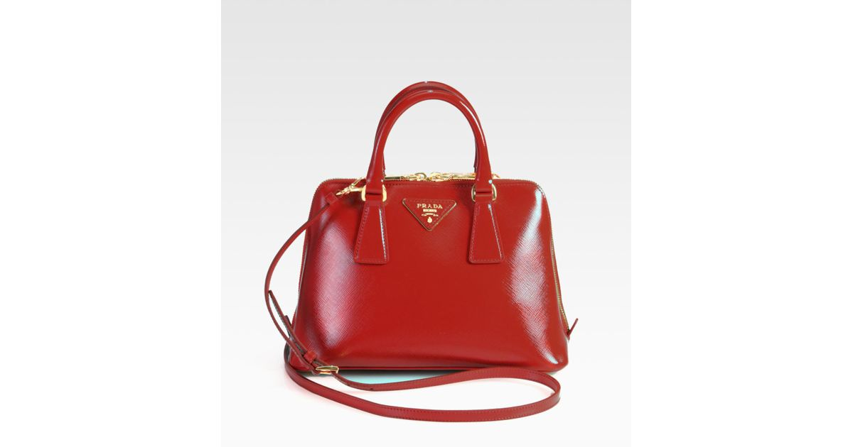c690b834eb6f ... get lyst prada saffiano vernice small round tophandle bag in red 9c412  48aa6
