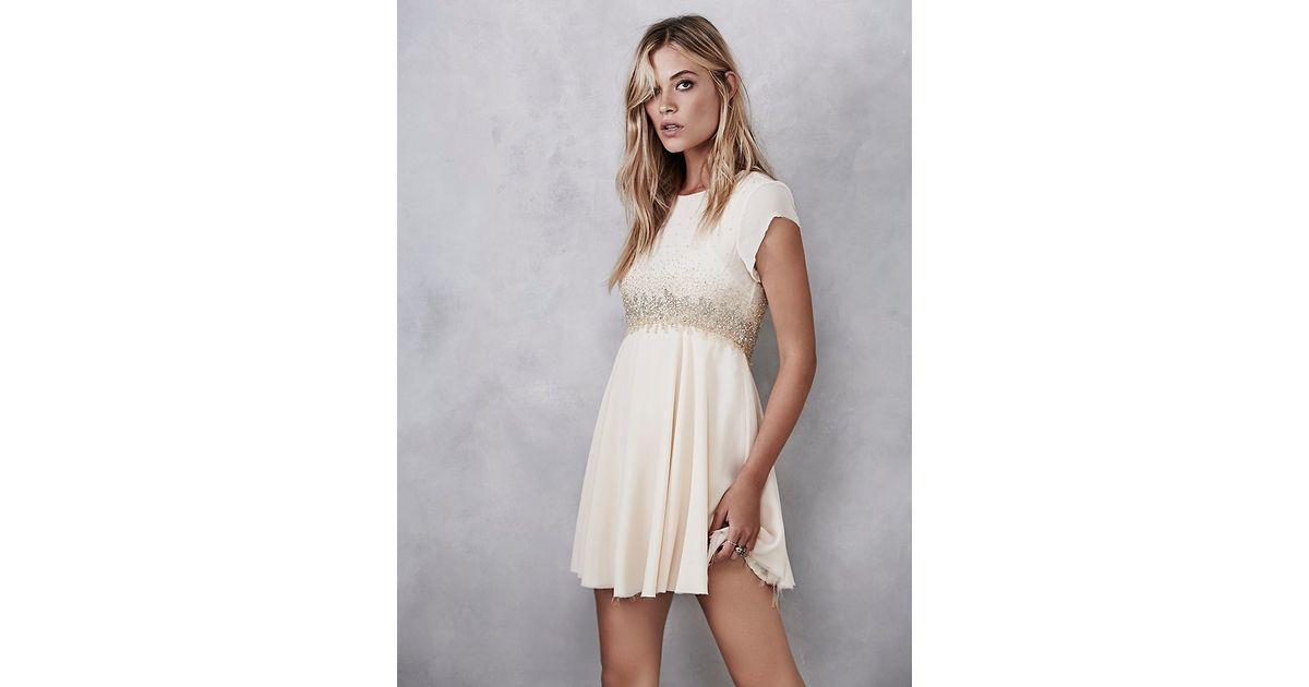 78f1769d231 Lyst - Free People Glitter Rock Babydoll Dress in Natural