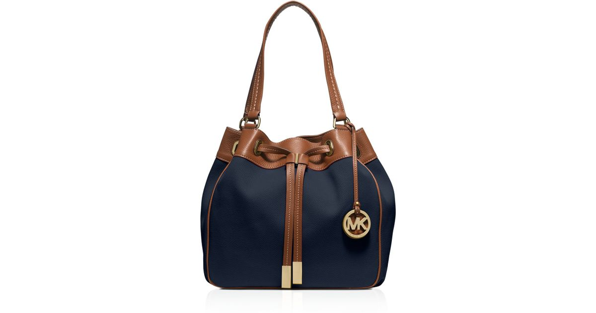 544e126ec8fd Michael Kors Marina Large Canvas Drawstring Tote in Blue - Lyst
