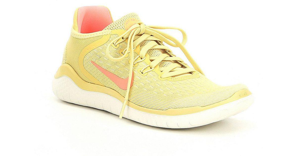 cf2e1dc824c8b ... orange 1fbd6 d6660  sale lyst nike womens free rn 2018 summer running  shoes in yellow 91c44 2083e
