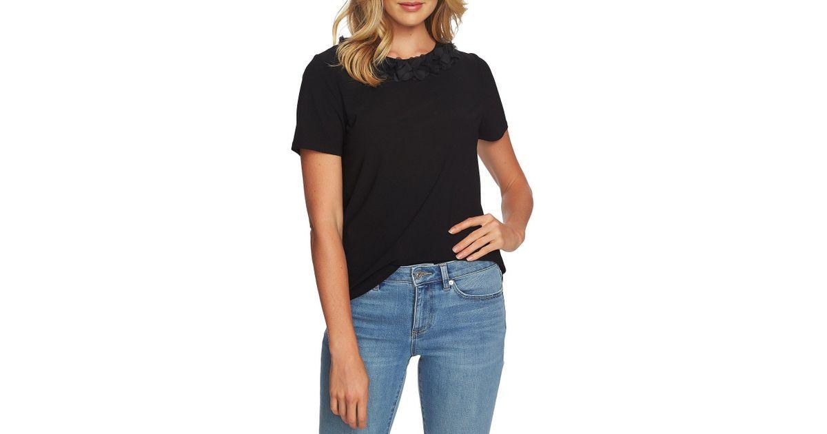 e2c362b6ce1 Lyst - Cece Short Sleeve Flower Detail Knit Top in Black