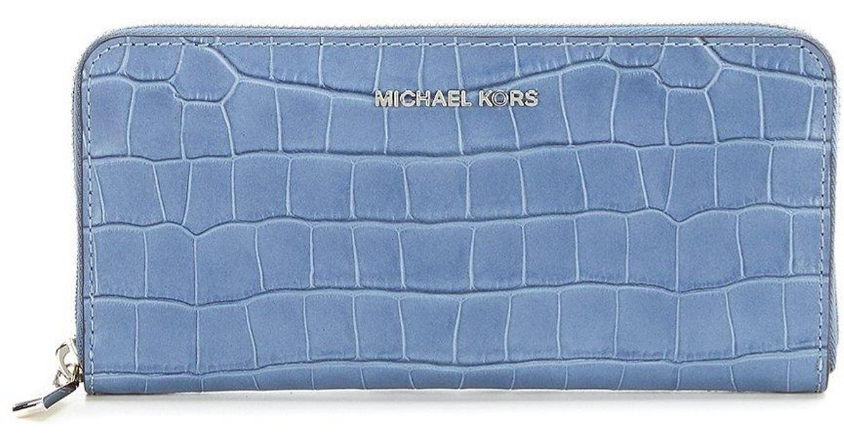 2c16a611a9be Lyst - MICHAEL Michael Kors Mercer Crocodile-embossed Continental Wallet in  Blue