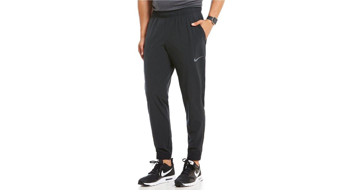 00399a43001a Lyst - Nike Flex Essential Training Pants in Gray for Men