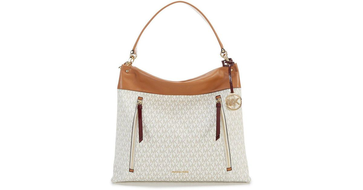 ff3e6eac8261d4 Michael Kors Signature Monogram Jet Set Carry All Tote in vanilla Image 0 .