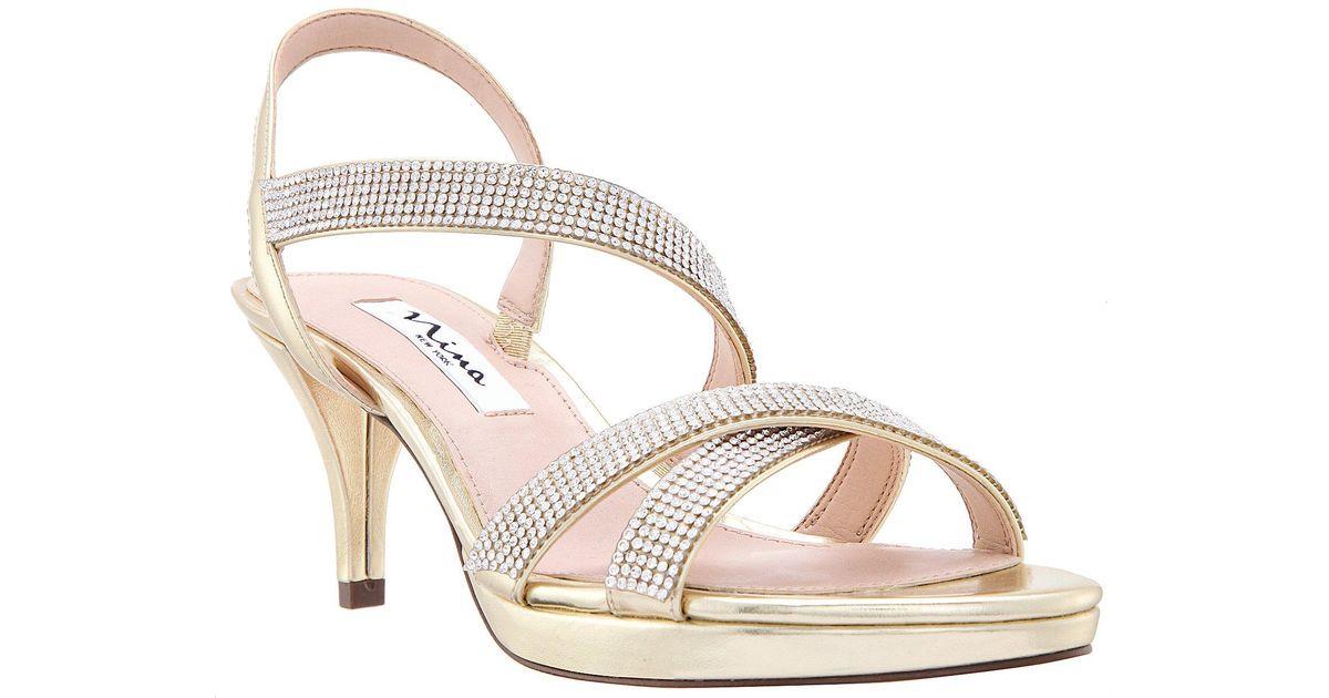 00c017d7d Lyst - Nina Nizana Jeweled Strappy Metallic Dress Sandals