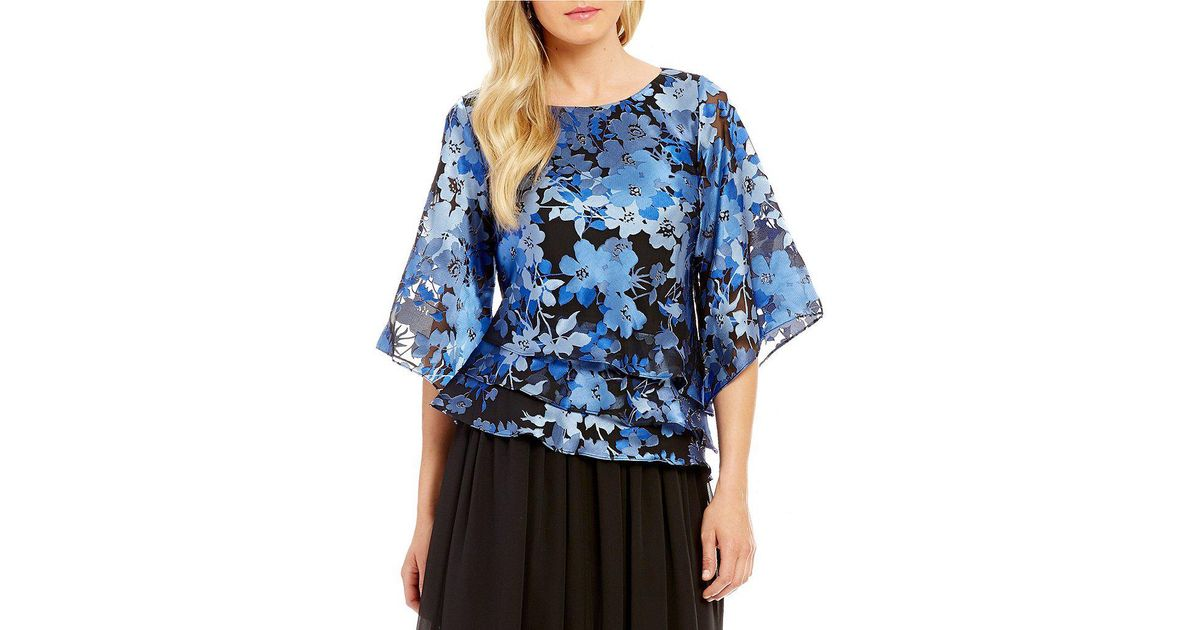 9651cabdd32363 Lyst - Alex Evenings Asymmetrical Tiered Floral Blouse in Blue