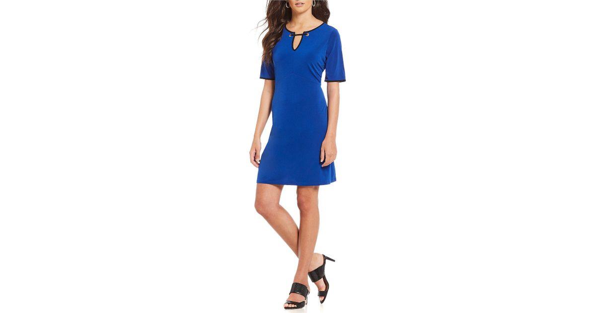 e580cf11552 Lyst - Ivanka Trump Matte Jersey Grommet Trim Split Neck Short Sleeve Dress  in Black