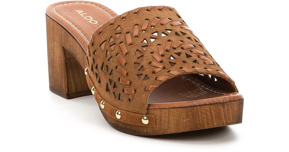 ad361622e9565 ALDO Deliodien Leather Perforated Wood Block Heel Mules in Brown - Save 40%  - Lyst