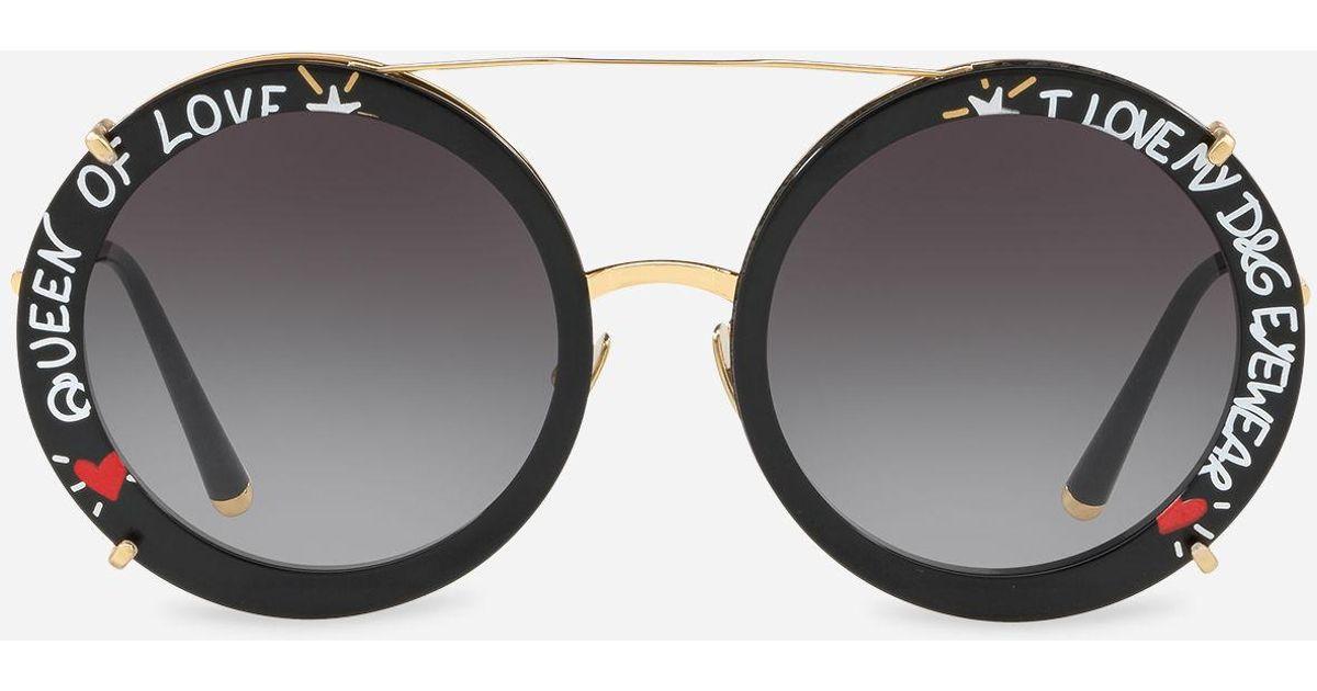 811e00e9650 Lyst - Dolce   Gabbana Round Clip-on Sunglasses In Gold Metal With Graffiti  Print in Metallic