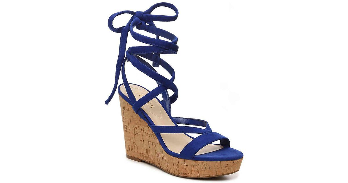 0c2a47acba7 Lyst - Guess Treacy Wedge Sandal in Blue