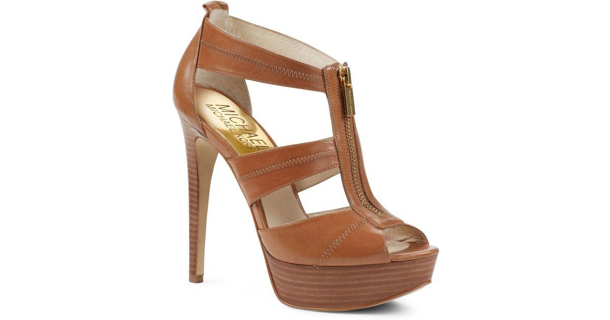 3284713c236 Lyst - Michael Kors Berkley Tstrap Sandal in Brown