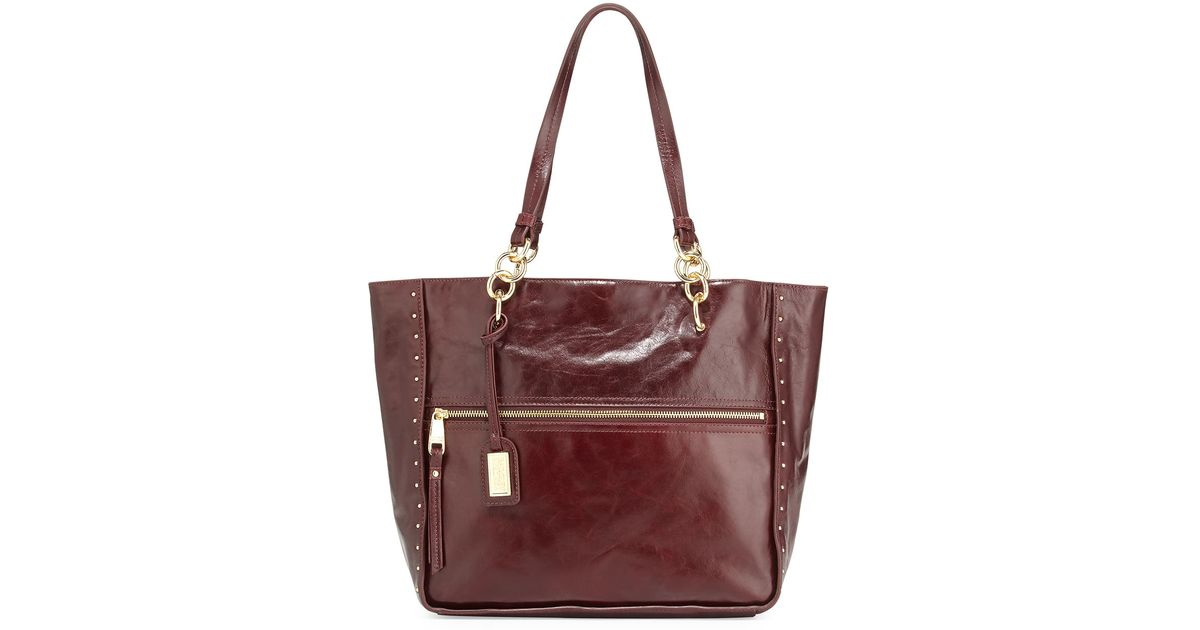 Lyst - Badgley Mischka Tessa Shine Studded Zipfront Leather Tote Bag Garnet  in Red d216a04befd72