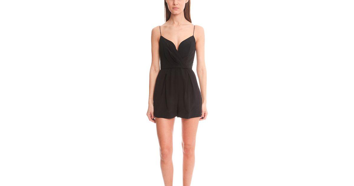 8a55bbfa27 Zimmermann Silk Plunge Playsuit in Black - Lyst
