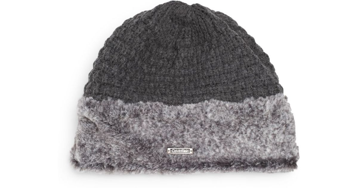 Lyst - Calvin Klein Faux Fur-trimmed Knit Hat in Gray cf03ef1c7a2