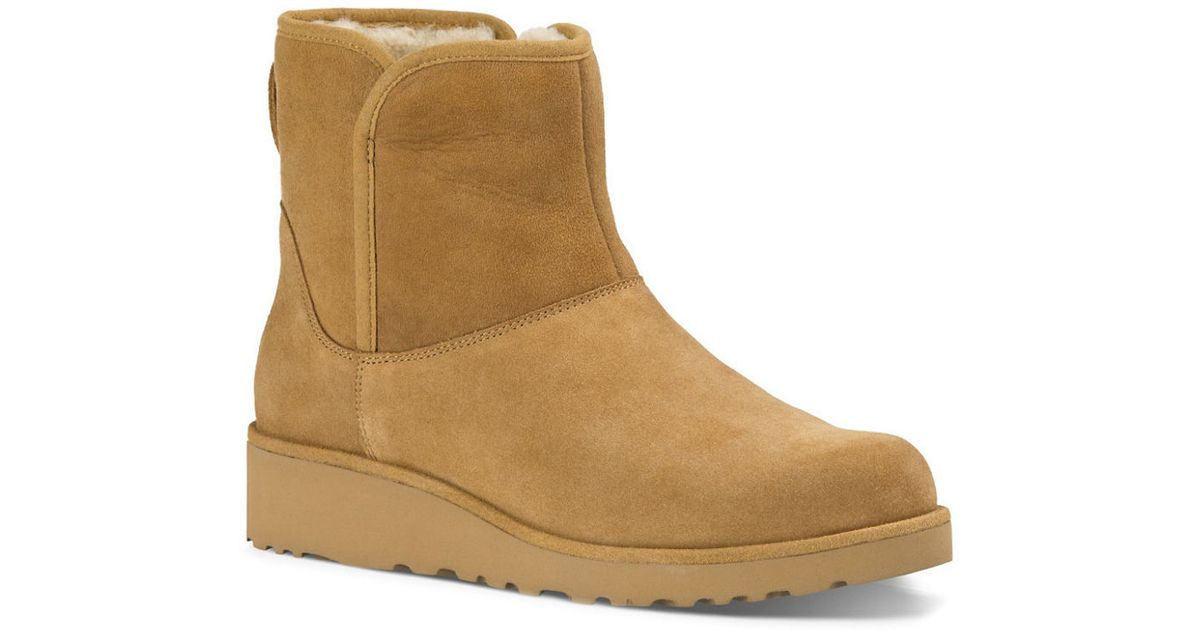 ugg kristin sheepskin wedge ankle boots in brown lyst