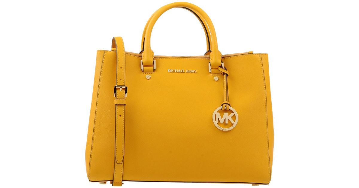 Lyst Michael Michael Kors Handbag In Yellow