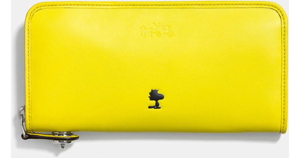 cefda11fe9 COACH Yellow X Peanuts Accordion Zip Wallet In Leather