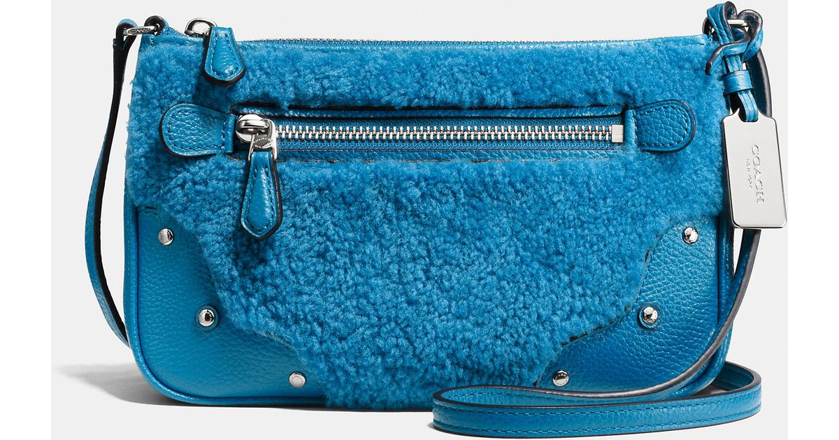 0ac0a4ebf4a COACH Rhyder Small Leather and Shearling Shoulder Bag in Blue - Lyst