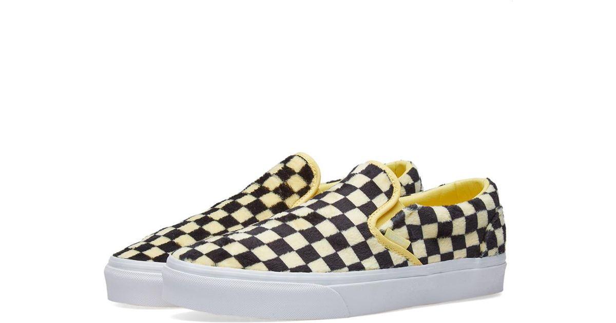 c179eb70907328 Lyst - Vans Women s Ua Classic Slip On Furry Checkerboard in Yellow