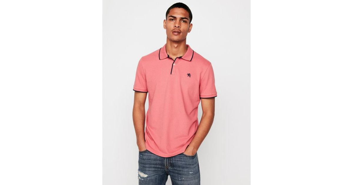Express Solid Tipped Small Lion Stretch Pique Polo in Pink for Men - Lyst caf34548f1d54