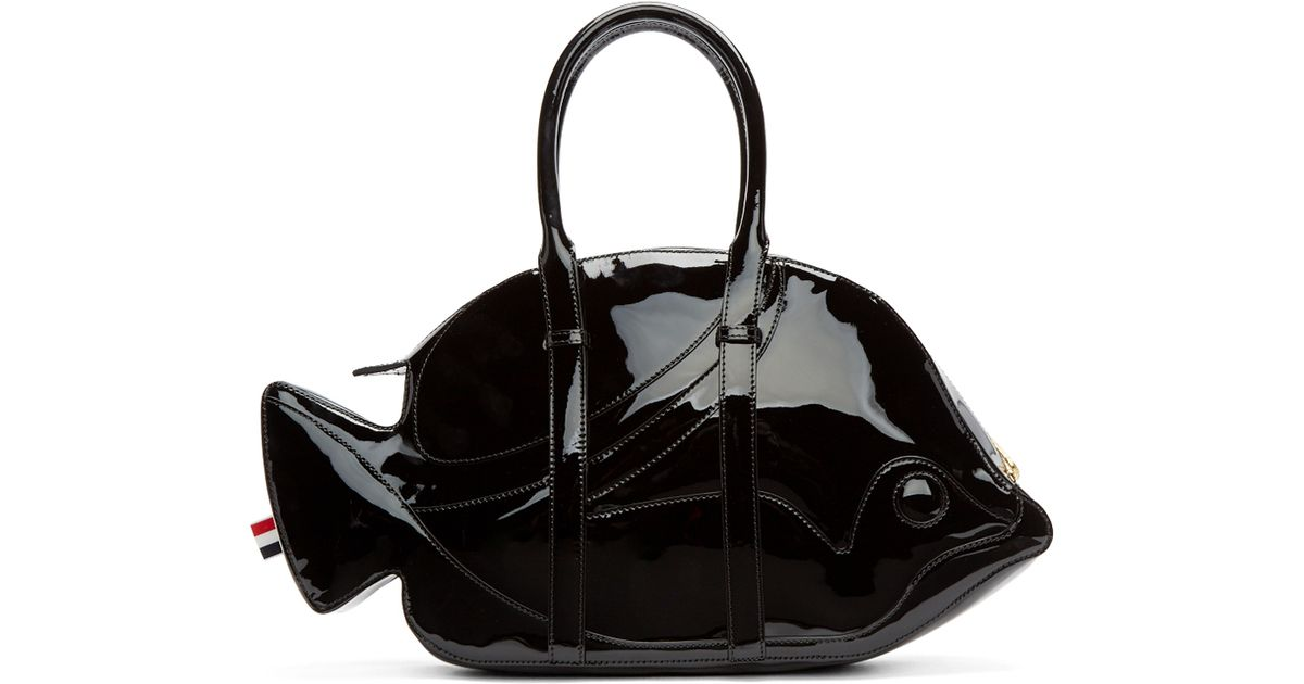 Black patent leather duffle bag