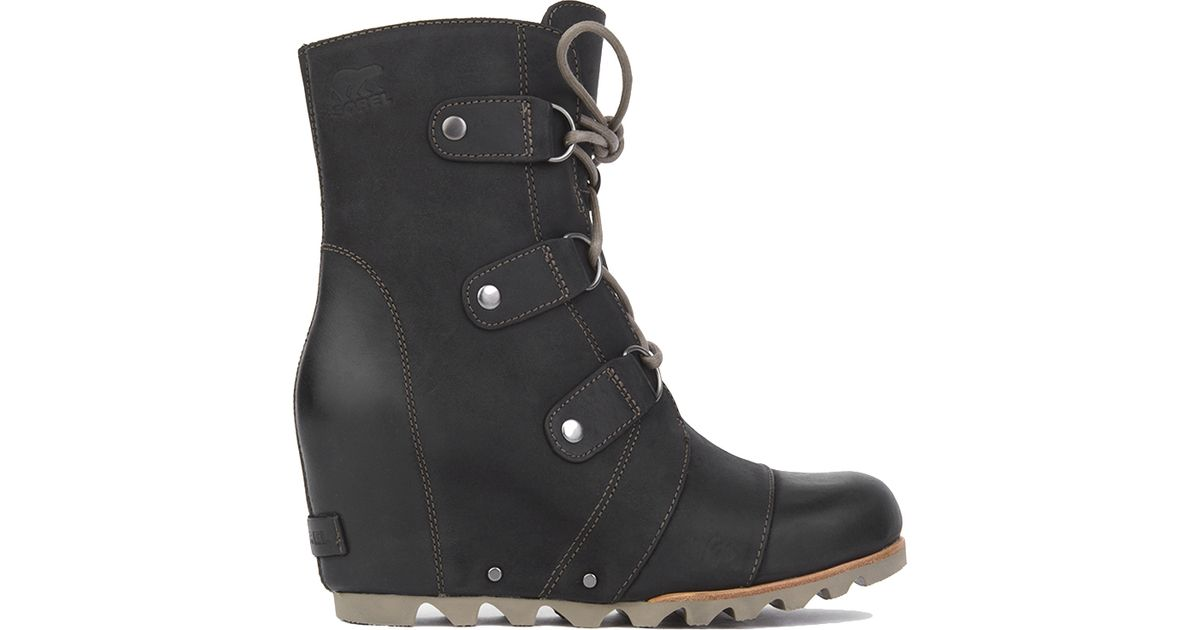 Lyst Sorel Joan Of Arctic Wedge Mid Boots Black In Black