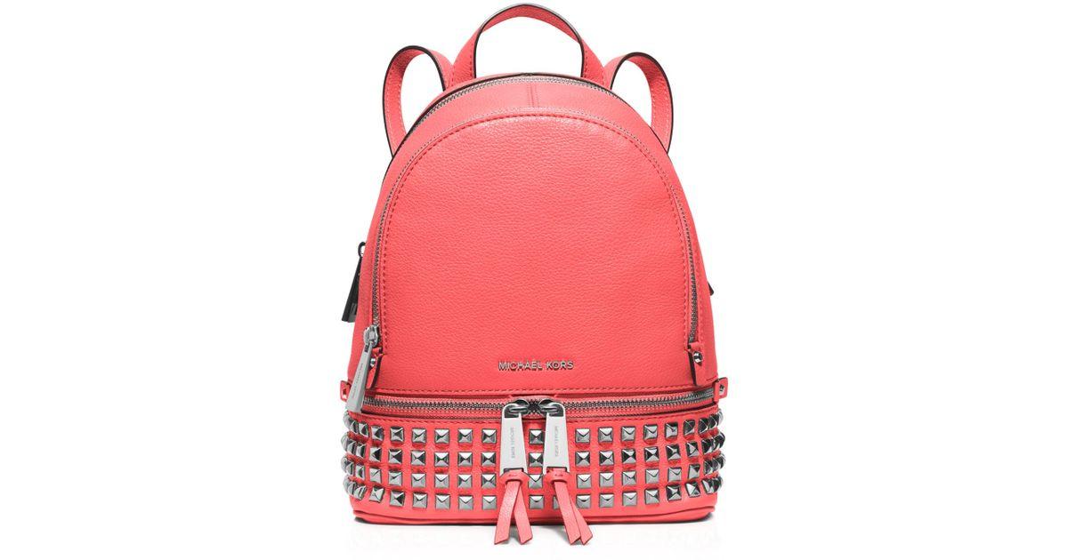 611a9a7562e0 ... shop lyst michael michael kors extra small rhea zip backpack in pink  9b8ad 5f9db