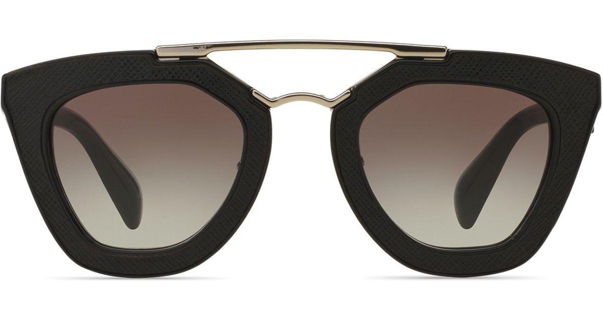aded55a8b8e8 Lyst - Prada Ornate Saffiano Leather Cat Eye Sunglasses