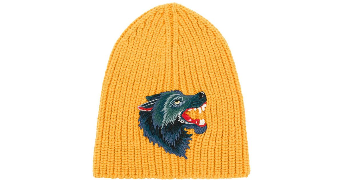 34a342618a3 Lyst - Gucci Knitted Wolf Beanie in Orange for Men