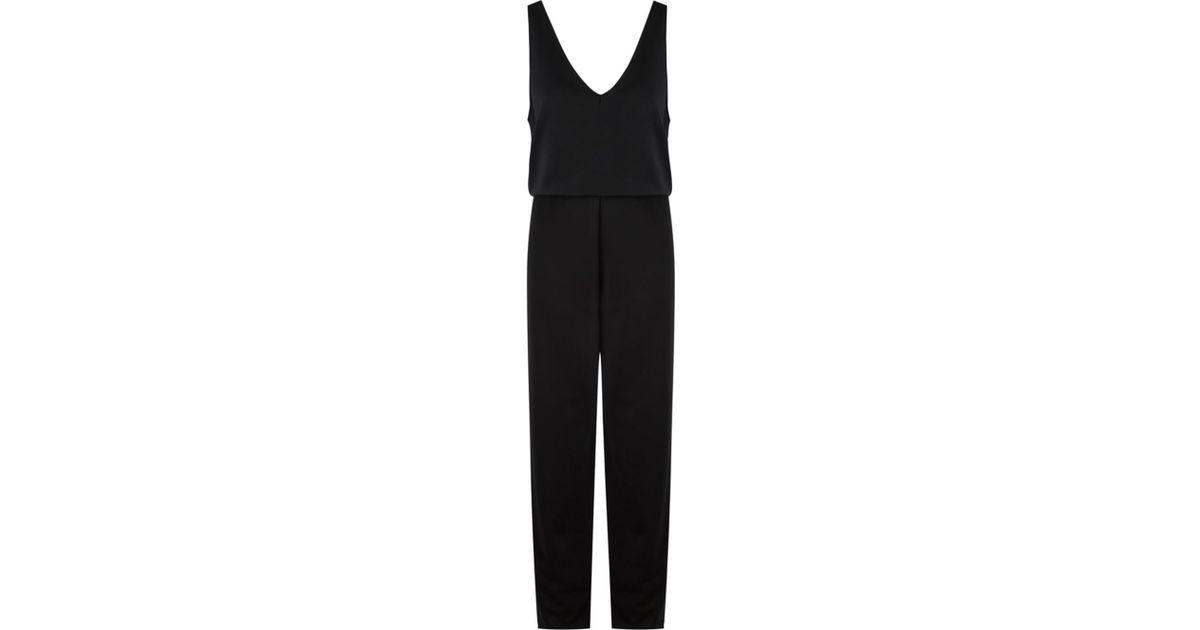 fb33e3d5f5f Lyst - Gloria Coelho Belted Sleeveless Jumpsuit in Black