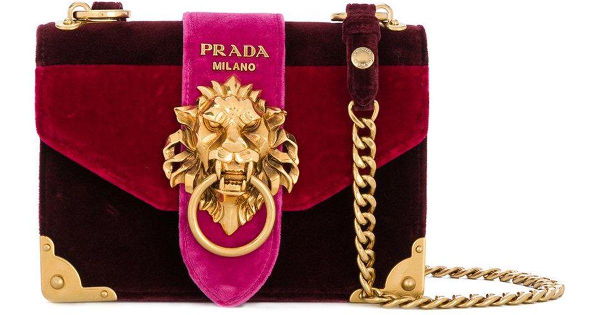 9875cd9e96a6 ... closeout prada cahier lion embellished shoulder bag lyst 378cc a6ec5
