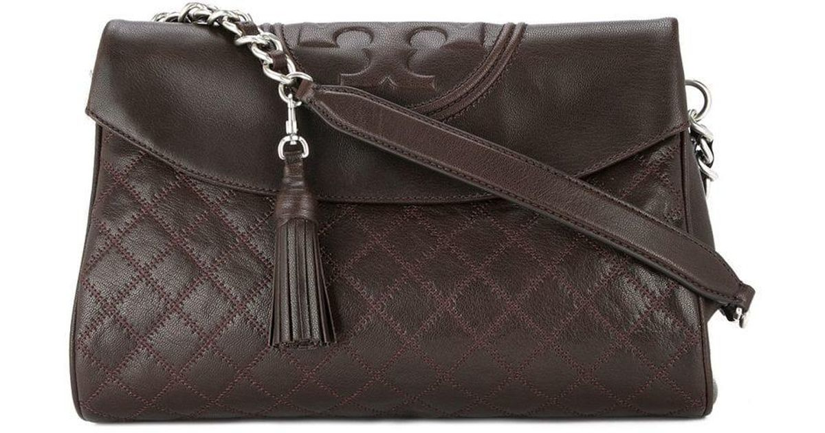 e3e3a41095b Lyst - Tory Burch Fleming Distressed Foldover Hobo Bag in Brown