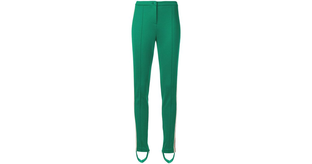 bb379fa7bc96 Lyst - Gucci Logo Stirrup Trousers in Green