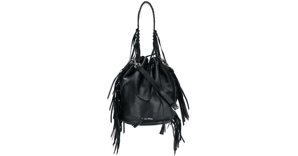 b63c3d11b636 Lyst - Miu Miu Tassel-trimmed Bucket Bag in Black