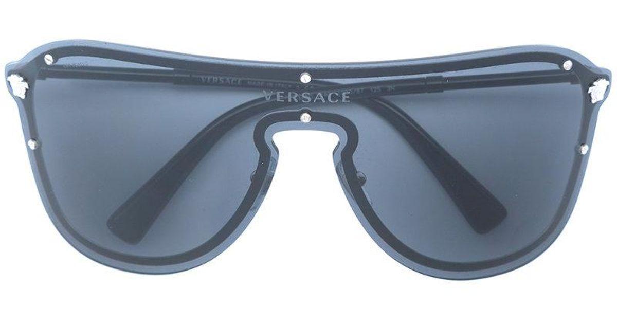 3c4206babc20 Lyst - Versace Frenergy Visor Sunglasses in Black
