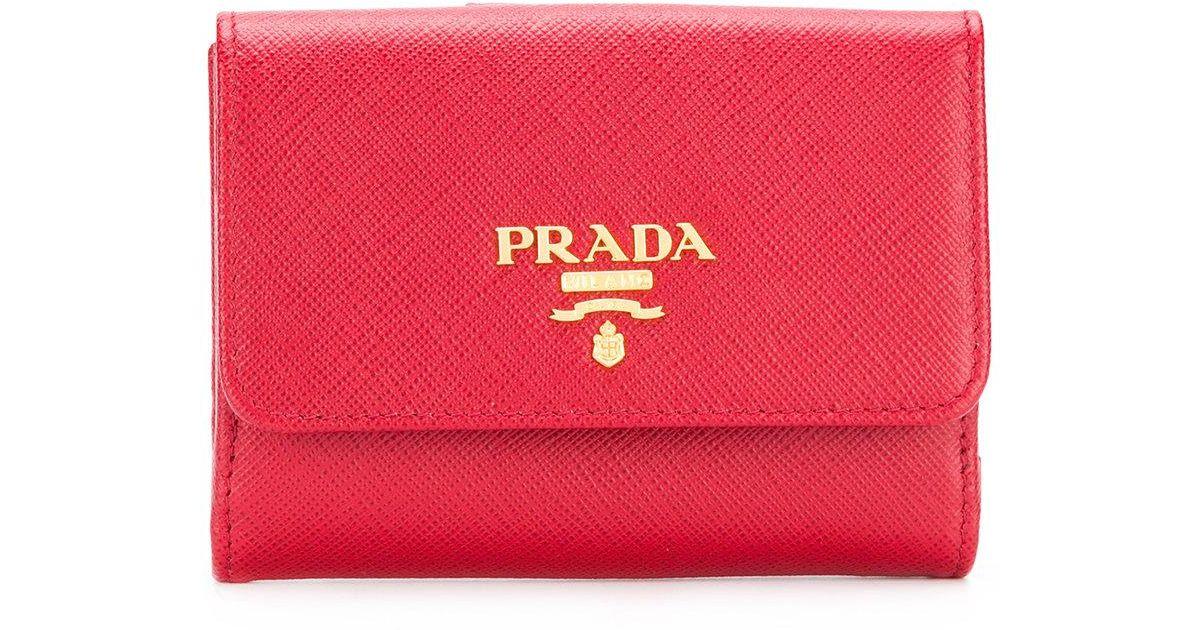 5b94a0519648 Lyst - Prada Logo Plaque Flap Wallet in Red