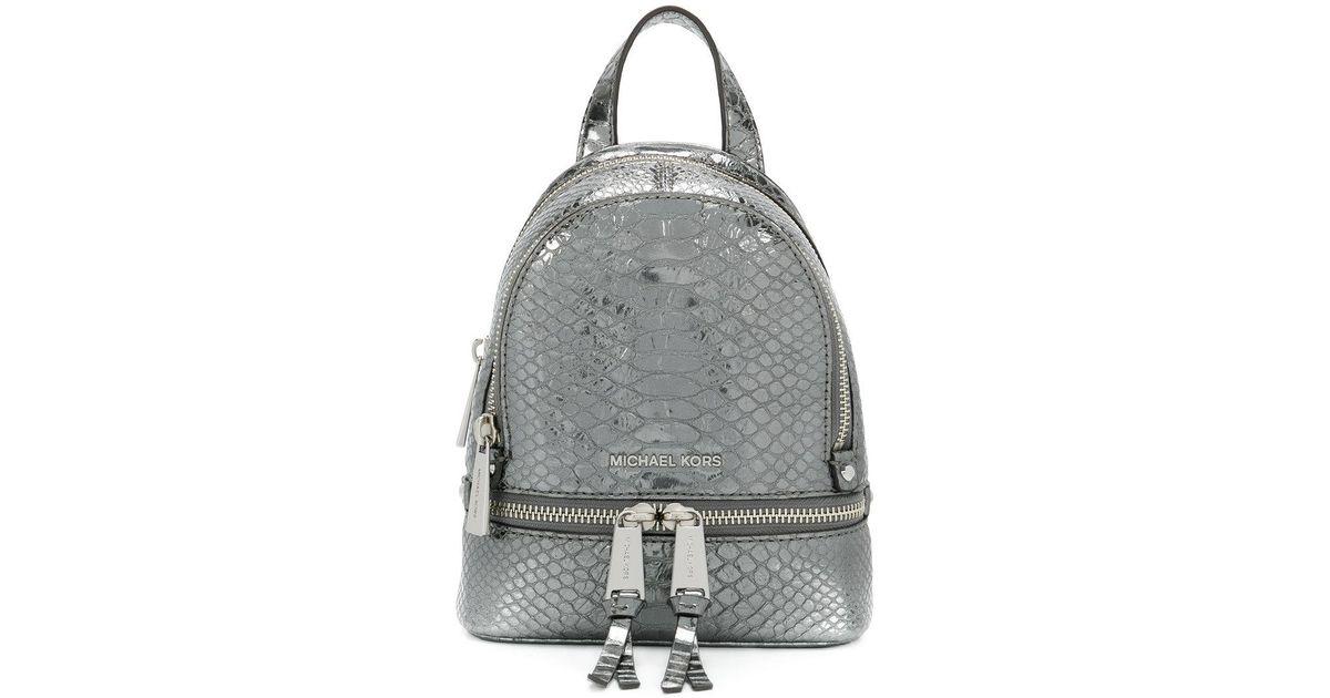 0fd2b84545eb1 Lyst - Michael Kors Mini Backpack in Gray