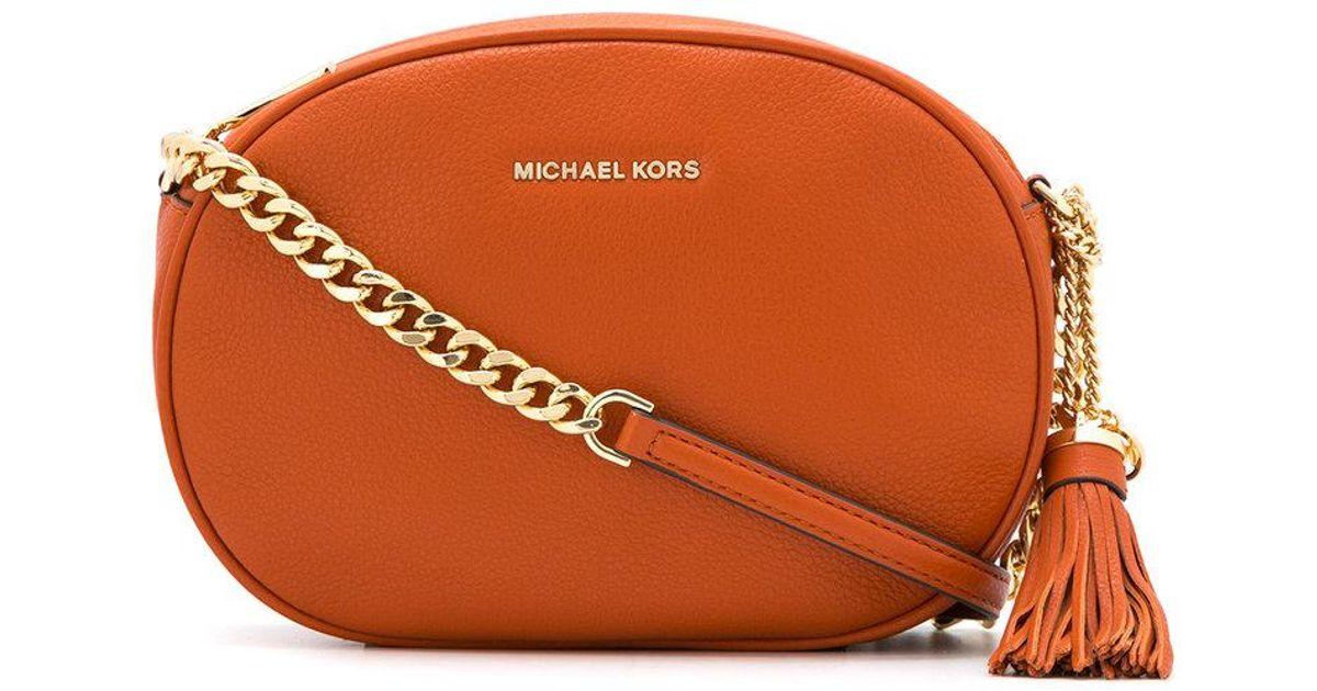 08879fb1665f discount michael kors black messenger bag b50ab 7fdf8  cheap lyst michael  michael kors ginny md messenger in orange 9e8c5 68d12