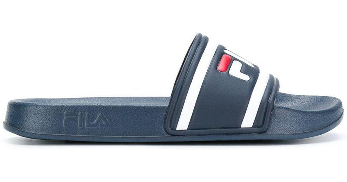 154eb622cad2 Lyst - Fila Logo Slides in Blue