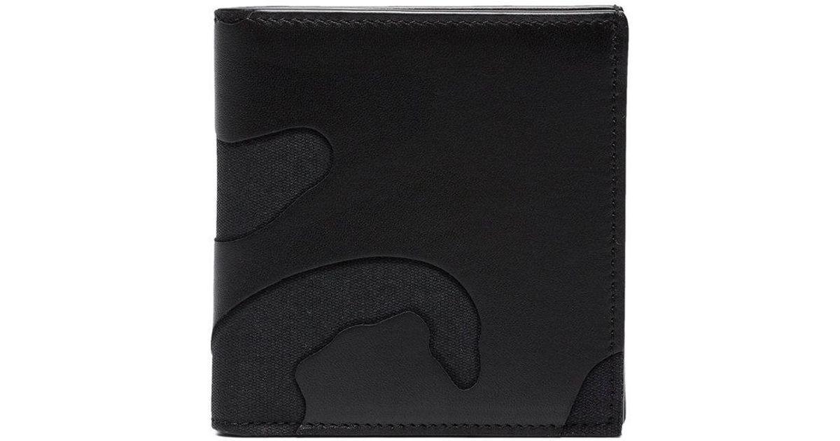 8bfac3b3c Lyst - Billetera con motivo militar Garavani Valentino de hombre de color  Negro