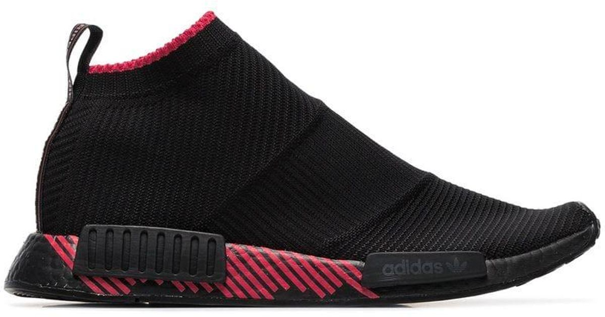 Adidas black NMD CS1 knitted low top sneakers $230 Shop