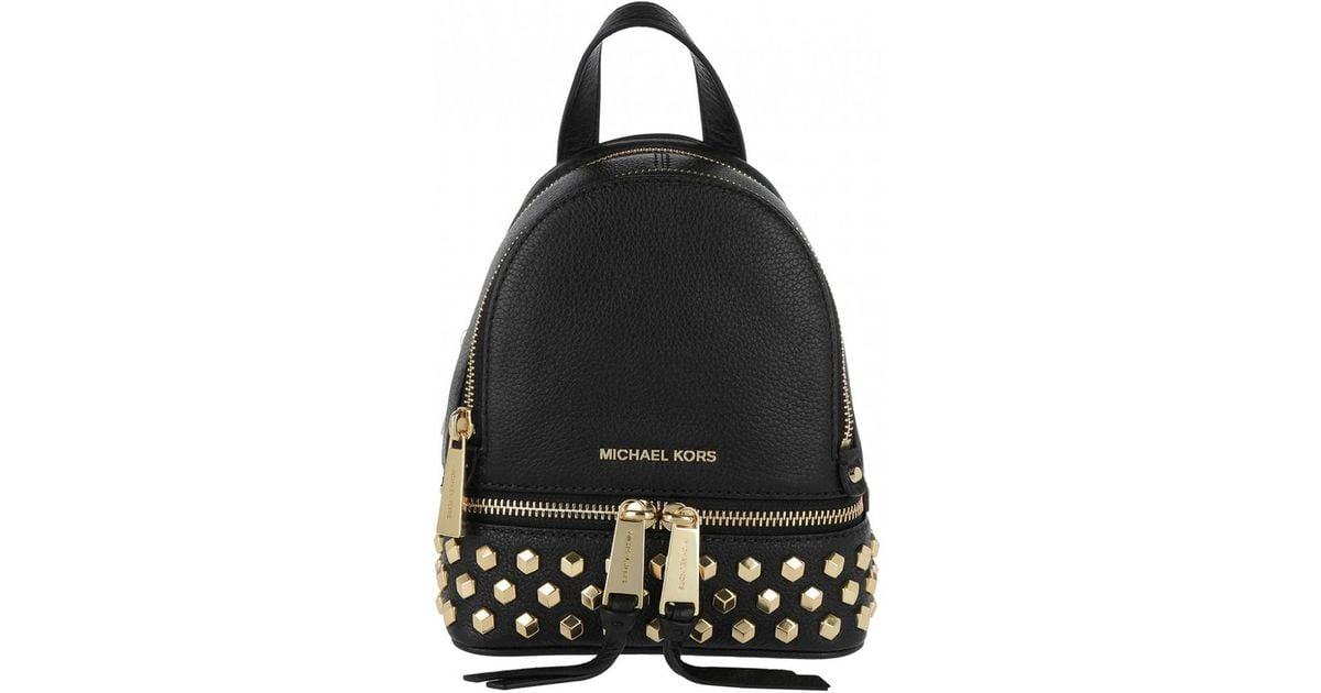 32184e45cf48 Michael Kors Rhea Zip Xs Messenger Backpack Gold Black in Metallic - Lyst