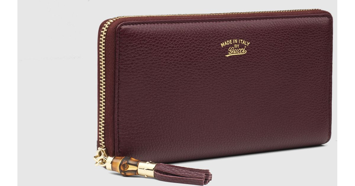 d4467ff4997 Lyst - Gucci Bamboo Tassel Leather Zip Around Wallet in Purple for Men