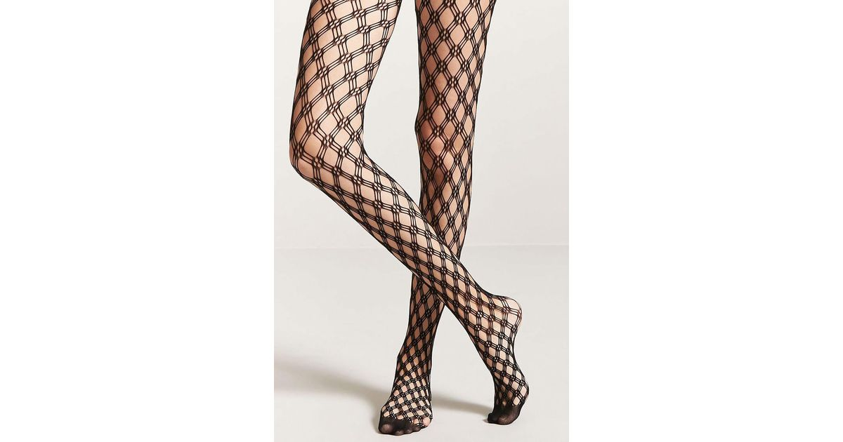 8d677adbf42 Lyst - Forever 21 Geo Fishnet Tights in Black