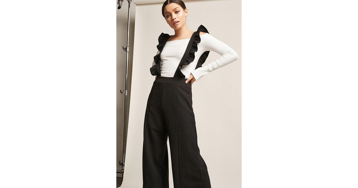 7f8f26b0be8 Lyst - Forever 21 Ruffle Suspender Jumpsuit in Black